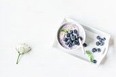 Healthy breakfast with yogurt, muesli and blueberry. Top view, flat lay