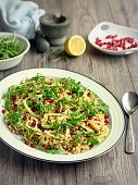 Home made healthy fennel and  quinoa, burghul salad with freshness rocket leaves and Pomegranate seeds
