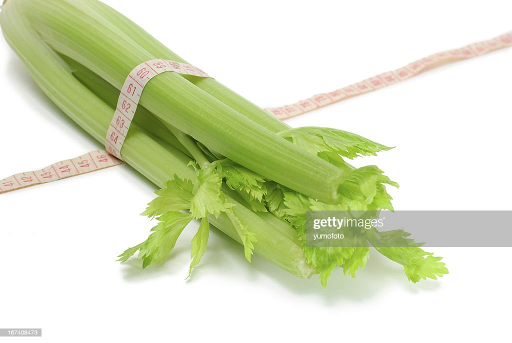 Healthy Celery in measuring tape : Stock Photo