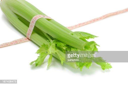 Healthy Celery in measuring tape : Stock Photo