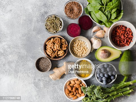 Healthy clean food - vegetables, fruits, nuts, superfoods on a gray background. Healthy eating concept. Top view. : Stock Photo
