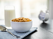 Healthy Corn Flakes with milk for Breakfast on table, food and drink