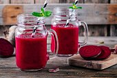 healthy detox beet smoothie with chia seeds in a mason jar on a wooden background