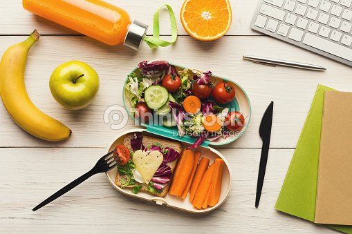 Healthy dinner from lunch box at office working table : Stock Photo