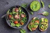 Vegan/vegetarian healthy dinner. Vegetable salad, sandwiches, fresh green smoothie. Healthy eating concept. Detox diet/plan. Top view. Vegetarian lunch. Weight loss. Cleanse program. Clean eating