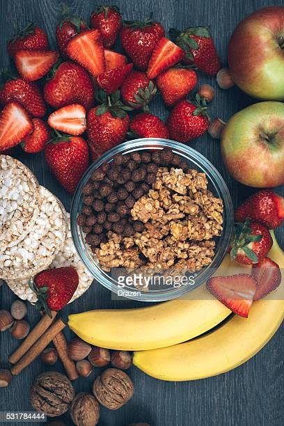 Healthy eating concept - strawberries, bananas and cereals
