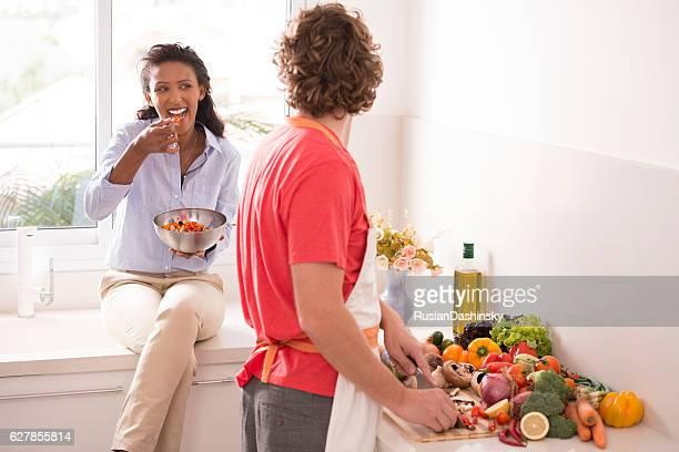 Healthy Eating. Couple preparing dinner.