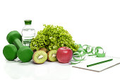 healthy eating, diet and weight loss, detox . dumbbells, kiwi and a bottle of water