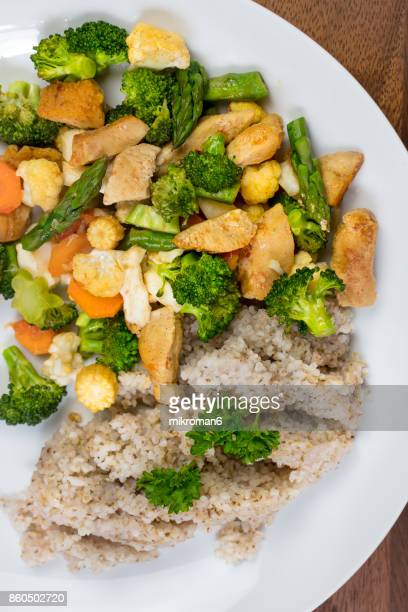 Healthy eating - fried chicken breast with vegetables and fine ground barley