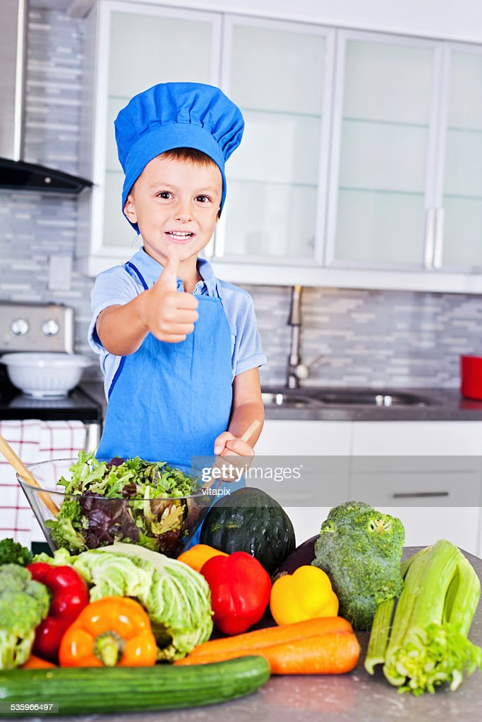 Healthy Eating - Little boy in the kitchen : Stock Photo