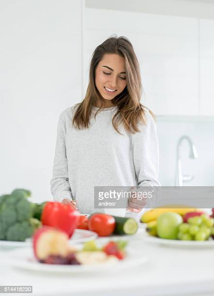 Healthy eating woman cooking at home