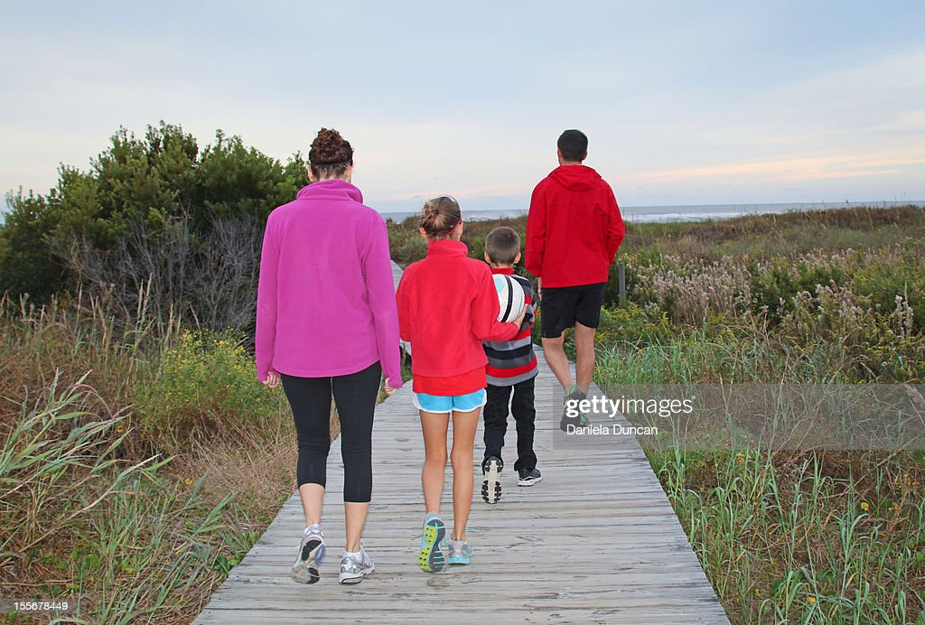 Healthy family walking to the beach : Stock Photo
