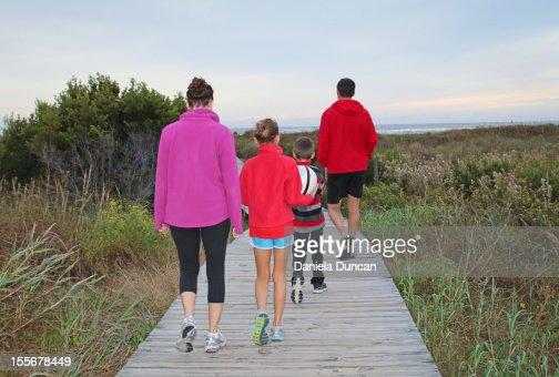 Healthy family walking to the beach : Stock Photo