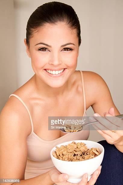 healthy female eating fiber cereal