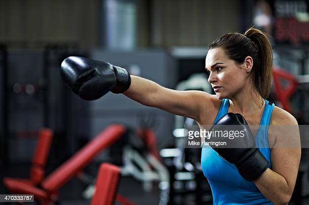 Healthy Female Sparring with Boxing Gloves