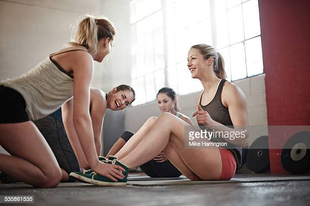 Healthy females working out in industrial gym