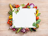 Healthy food background and Copy space / studio photography of open blank ring bound notebook surrounded by a fresh vegetables and pencil on old wooden table