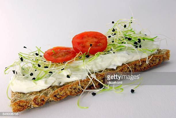 healthy food crispbread with curd cheese and tomatoes