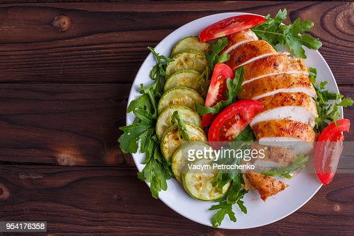 Healthy food, diet concept. Baked chicken breasts with zucchini : Stock Photo
