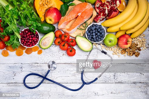 Healthy food for heart. Fresh fish, fruits, vegetables, berries and nuts. Healthy food, diet and healthy heart concept : Foto de stock