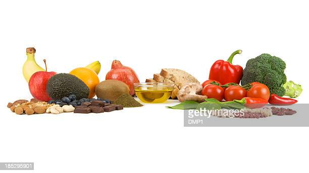 Healthy food groups often called Superfoods on a white background