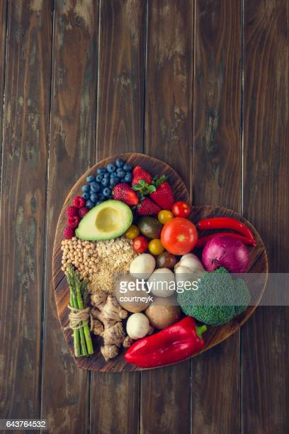 Healthy food on a heart shape cutting board