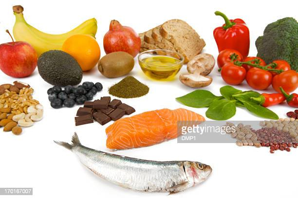 Healthy fresh food groups known as Superfoods on white background