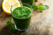 Healthy freshly made green smoothie with spinach and kale