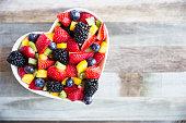 Healthy fresh fruit salad with strawberries, blackberries, mango, blueberries and kiwi.