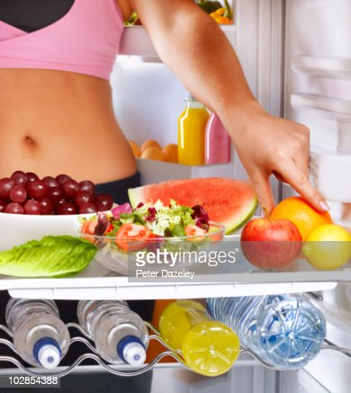 Healthy girl eating for a healthy lifestyle : Stock Photo