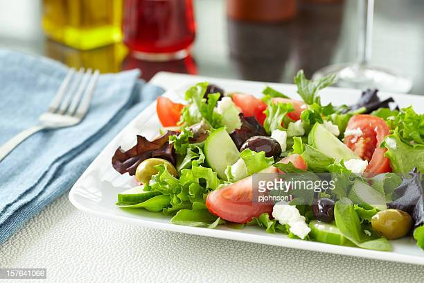 Healthy Greek salad with olives, feta on table for a meal