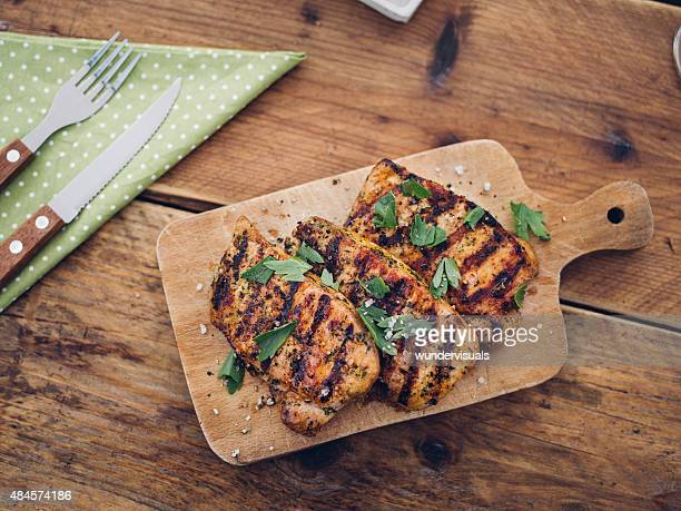 Healthy grilled pork fillets sprinkled with fresh herbs