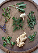 Healthy Herbs, Garlic, and Ginger Root on a Tray