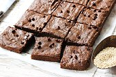 Healthy Homemade chocolate Quinoa Brownies on white wooden background, selective focus