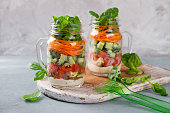 Healthy homemade mason jar salad with chicken and vegetables - healthy food, diet, detox concept, selective focus