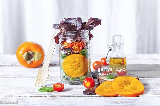 Healthy homemade Mason Jar salad with Persimmon and veggies