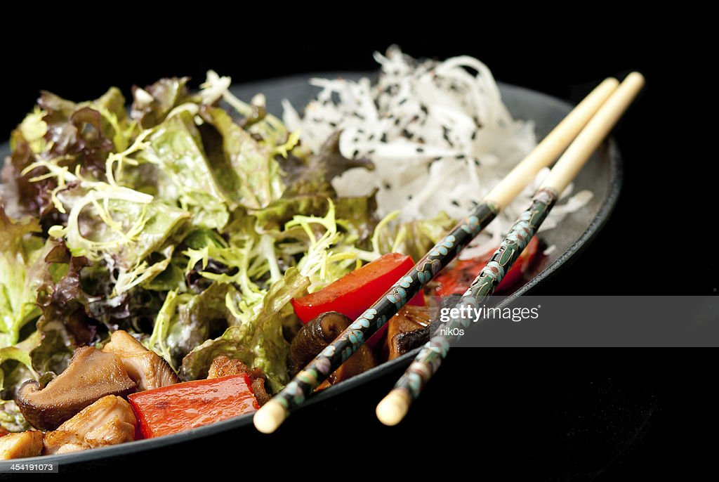 Healthy Japanese salad on the black plate : Stock Photo