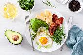 healthy keto breakfast: egg, avocado, cheese, bacon