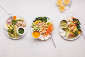 Zucchini noodles, vegetables, chickpeas, creamy tahini dressing bowls  food concept