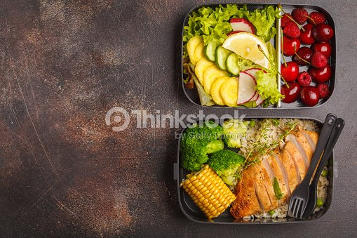 Healthy meal prep containers with grilled chicken with fruits, berries, rice and vegetables. Takeaway food, copy space : Stock Photo