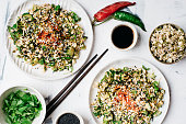 Healthy mung bean sprouts salad with black sesame seeds, cucumbers, spring onion and cilantro. Asian food, healthy eating concept