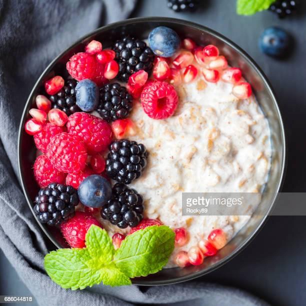 Healthy organic porridge topped with berries