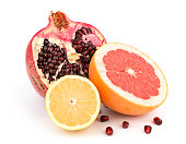 Healthy pomegranate and citrus fruits isolated on white background with shadow
