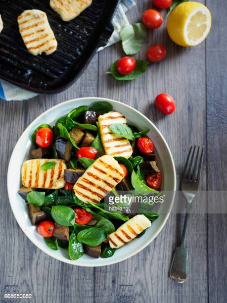 Healthy roasted vegetable salad with grilled halloumi cheese