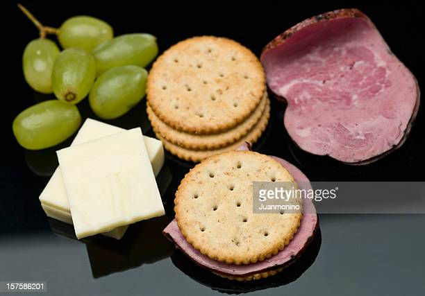 Healthy snacks of grapes, cheese, crackers and deli meats