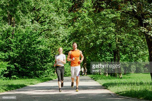 Healthy sporty couple jogging in the park together