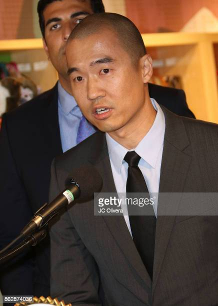 Healthy Spot owner Andrew Kim speaks during a press conference celebrating Calfornia Governor Jerry Brown signing California assembly Bill 485 The...
