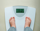 Healthy Weight Gain for Baby or Children Concept, A 2 Years Old Kid Standing on Weight Scales, Top View
