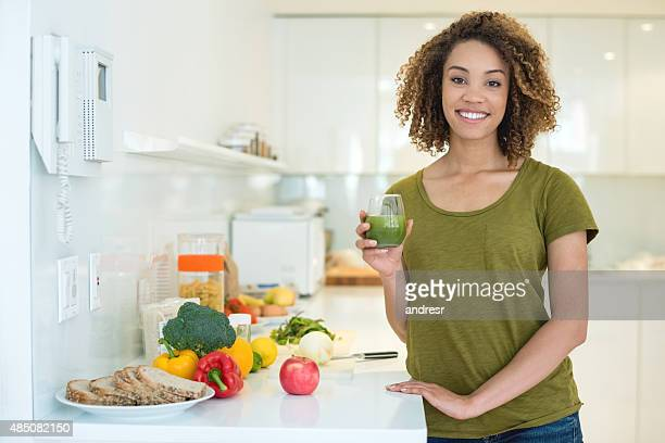 Healthy woman drinking a green juice
