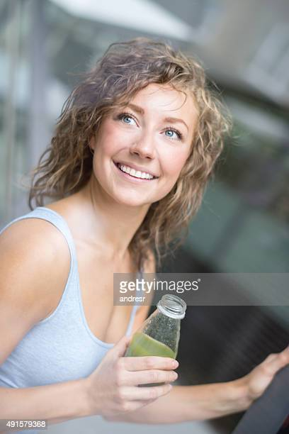 Healthy woman drinking an organic juice